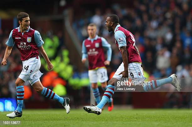 Darren Bent of Aston Villa celebrates with Matthew Lowton after scoring the equalizing goal during the Barclays Premier League match between Aston...