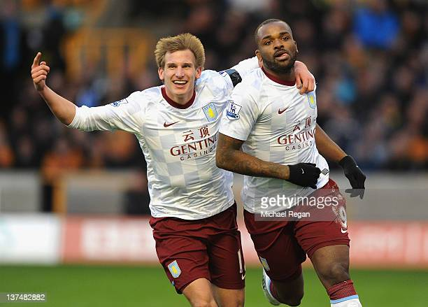 Darren Bent of Aston Villa celebrates with teammate Marc Albrighton after scoring the opening goal from a penalty during the Barclays Premier League...