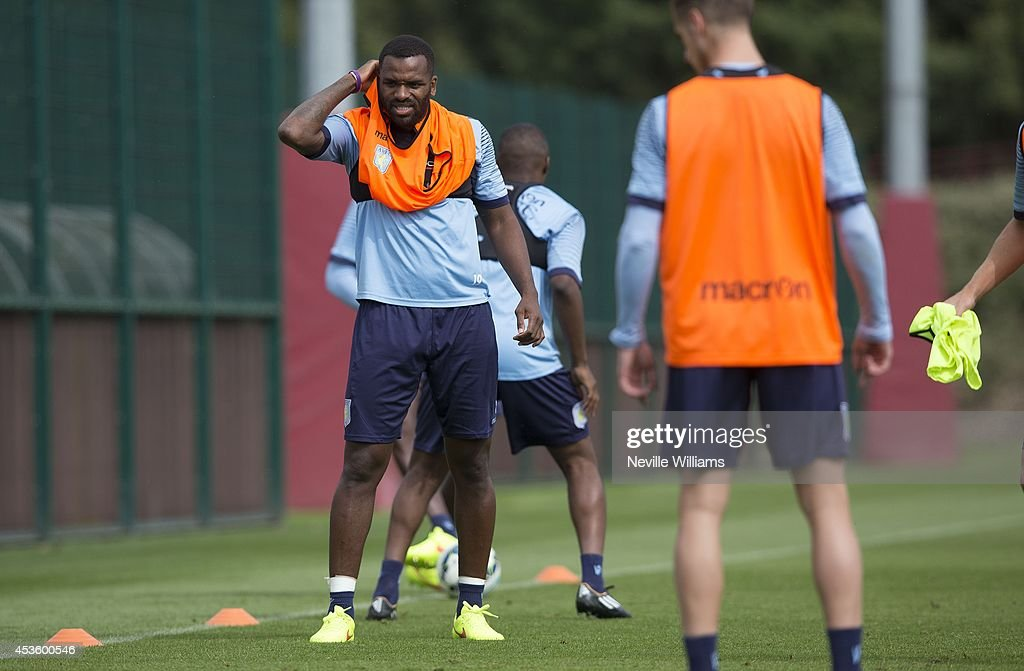 Darren Bent of Aston Villa in action during an Aston Villa training session at the club's training ground at Bodymoor Heath on August 14, 2014 in Birmingham, England.