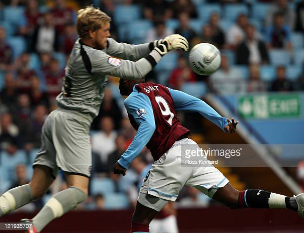 Darren Bent of Aston Villa is challenged by David Cornell of Hereford during the Carling Cup second round match between Aston Villa and Hereford...