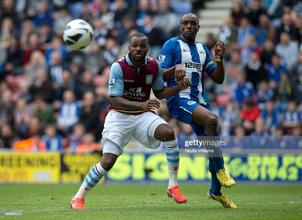 <a gi-track='captionPersonalityLinkClicked' href=/galleries/search?phrase=Darren+Bent&family=editorial&specificpeople=215162 ng-click='$event.stopPropagation()'>Darren Bent</a> of Aston Villa is challenged by Emmerson Boyce of Wigan Athletic during the Barclays Premier League match between Wigan Athletic and Aston Villa at DW Stadium on May 19, 2013 in Wigan, England.