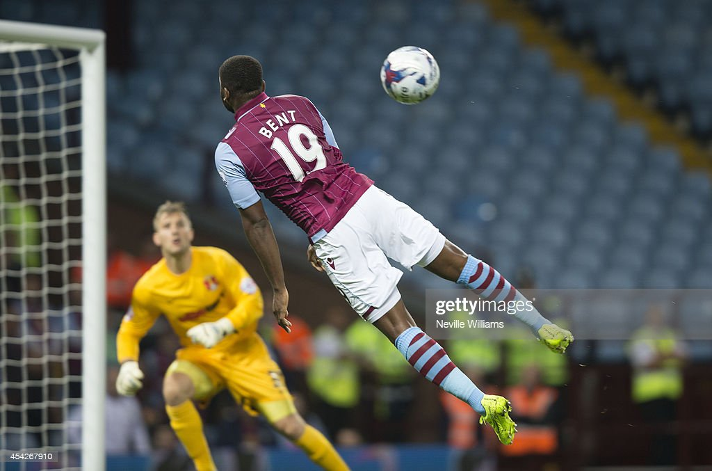 <a gi-track='captionPersonalityLinkClicked' href=/galleries/search?phrase=Darren+Bent&family=editorial&specificpeople=215162 ng-click='$event.stopPropagation()'>Darren Bent</a> of Aston Villa jumps during the Capital One Cup second round match between Aston Villa and Leyton Orient at Villa Park on August 27, 2014 in Birmingham, England.