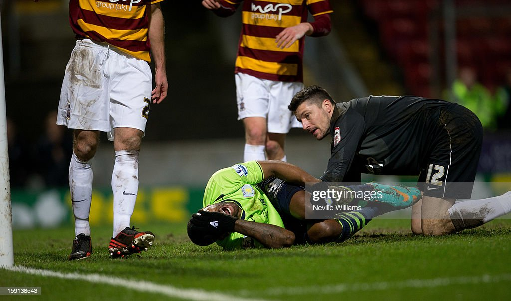 Darren Bent of Aston Villa lies injured during the Capital One Cup Semi-Final match between Bradford City and Aston Villa at Coral Windows Stadium on January 08, 2013 in Bradford, England.