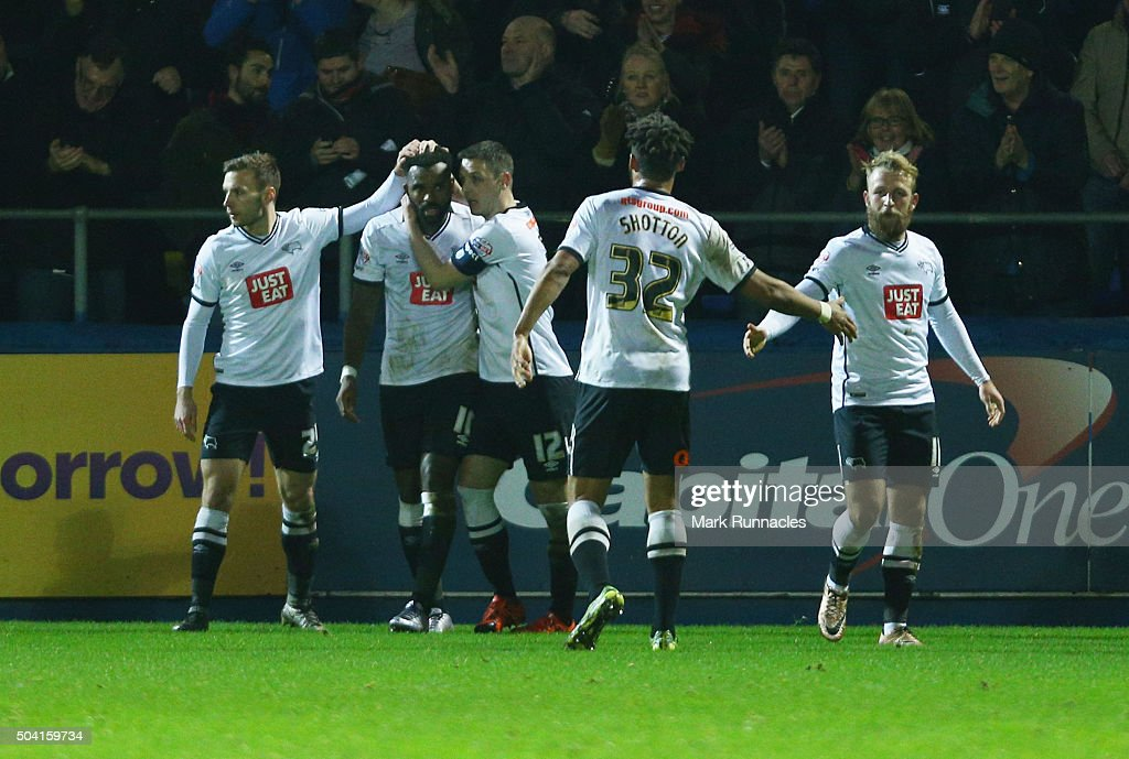 Darren Bent (2nd L) of Derby County celebrates scoring his team's second goal with his team mates during the Emirates FA Cup third round match between Hartlepool United and Derby County at Victoria Park on January 9, 2016 in Hartlepool, England.