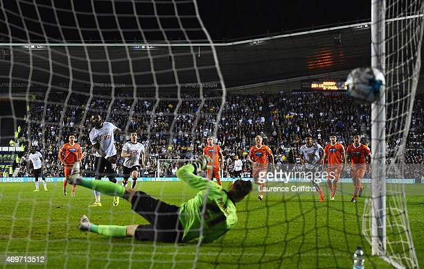 Darren Bent of Derby County scores their fourth goal from a penalty past goalkeeper Elliott Parish of Blackpool during the Sky Bet Championship match...
