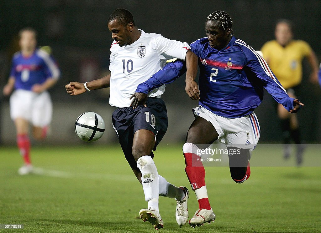 Darren Bent of England battles for the ball with Bakari Sagna of France during the international match between England U21s and France U21s at the...