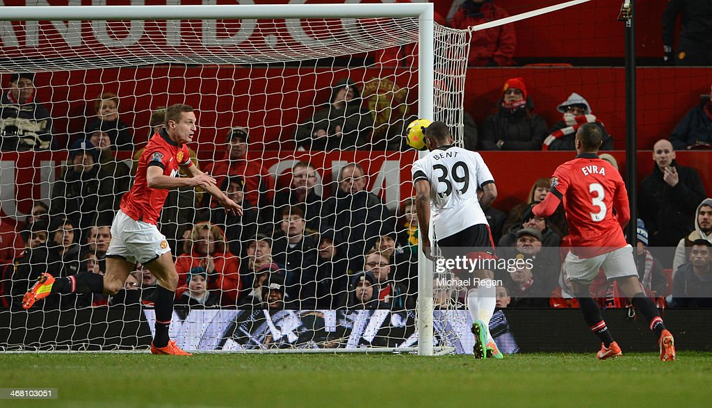 <a gi-track='captionPersonalityLinkClicked' href=/galleries/search?phrase=Darren+Bent&family=editorial&specificpeople=215162 ng-click='$event.stopPropagation()'>Darren Bent</a> of Fulham scores his team's second goal during the Barclays Premier League match between Manchester United and Fulham at Old Trafford on February 9, 2014 in Manchester, England.