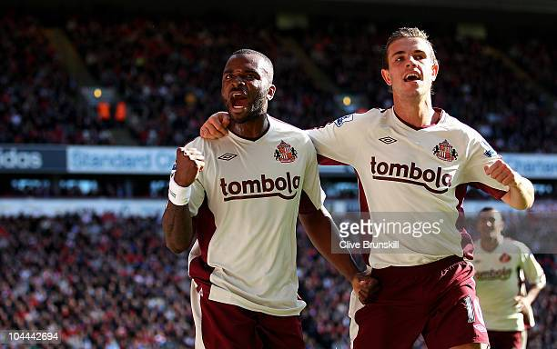 Darren Bent of Sunderland celebrates with team mate Jordan Henderson after scoring the equalizer from the penalty spot during the Barclays Premier...