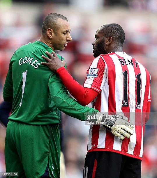 Darren Bent of Sunderland has a chat with Spurs goalkeeper Heurelho Gomes during the Barclays Premier League match between Sunderland and Tottenham...