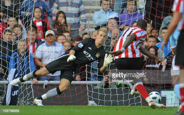 Darren Bent of Sunderland scores a penalty past Joe Hart of Manchester City during the Barclays Premier League match between Sunderland and...