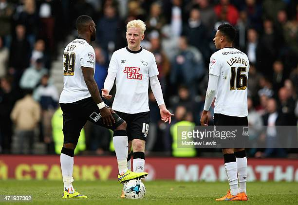 Darren Bent Will Hughes and Jesse Lingard of Derby look on after Reading scored their third goal during the Sky Bet Championship match between Derby...