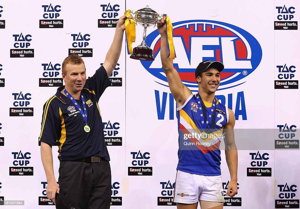 Darren Bewick the coach of the Ranges and Ben Cavarra the captain hold up the Premiership Cup after winning the TAC Cup final match between Eastern Ranges and the Dandenong Southern Stingrays at Etihad Stadium on September 22, 2013 in Melbourne, Australia.