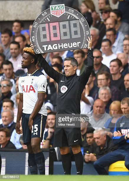Darren Bond holds up the substitute board during the Premier League match between Tottenham Hotspur and Crystal Palace at White Hart Lane on August...
