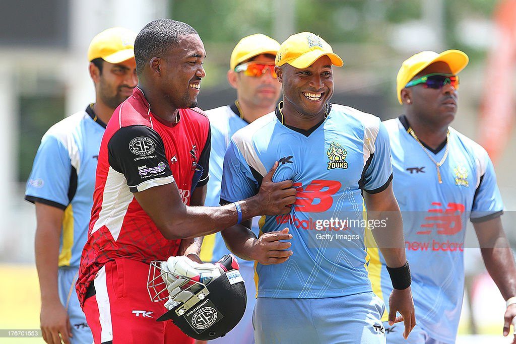 Darren Bravo and Tino Best during the Eighteenth Match of the Cricket Caribbean Premier League between St. Lucia Zouks v Trinidad and Tobago Red Steel at Sabina Park on August 17, 2013 in Kingston, Jamaica.