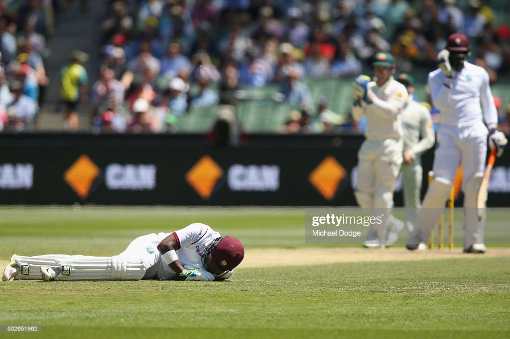 <a gi-track='captionPersonalityLinkClicked' href=/galleries/search?phrase=Darren+Bravo&family=editorial&specificpeople=4884685 ng-click='$event.stopPropagation()'>Darren Bravo</a> of the West Indies lays on the pitch after ducking a ball hit by <a gi-track='captionPersonalityLinkClicked' href=/galleries/search?phrase=Carlos+Brathwaite&family=editorial&specificpeople=8538686 ng-click='$event.stopPropagation()'>Carlos Brathwaite</a> of the West Indies celebrates his half century during day three of the Second Test match between Australia and the West Indies at Melbourne Cricket Ground on December 28, 2015 in Melbourne, Australia.