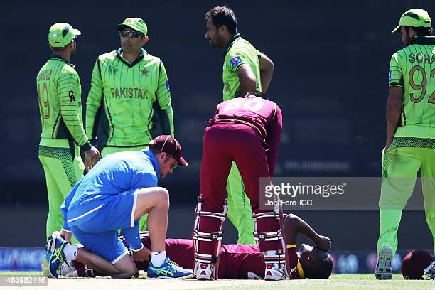 Darren Bravo of the West Indies lies on the ground after injuring himself during the 2015 ICC Cricket World Cup match between Pakistan and the West...