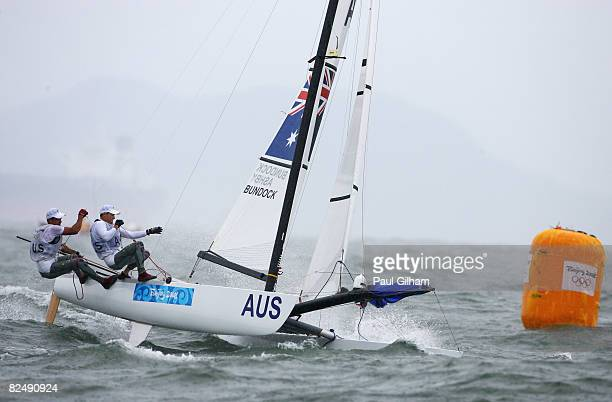 Darren Bundock and Glenn Ashby of Australia compete on their way to finishing second in the Tornado class event held at the Qingdao Olympic Sailing...