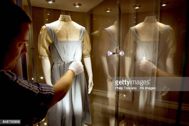 Darren C Julien from Julien's Auctions checks the dress that Judy Garland wore in the Wizard of Oz film The dress is on display at the Stafford Hotel...