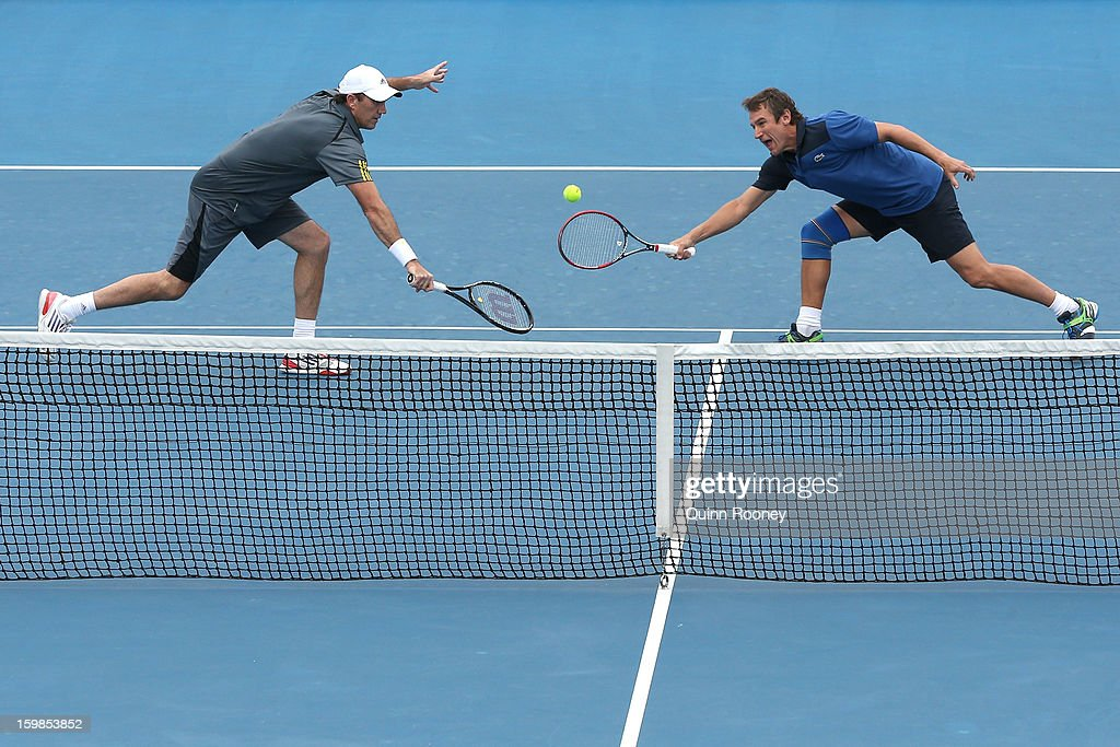 Darren Cahill of Australia plays a shot in his second round legends doubles match with Mats Wilander of Sweden against Jacco Eltingh of the Netherlands and Paul Haarhuis of the Netherlands during day nine of the 2013 Australian Open at Melbourne Park on January 22, 2013 in Melbourne, Australia.