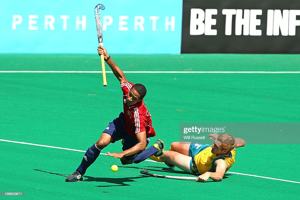 Darren Cheesman of England trips over Daniel Beale of the Kookaburras Australia v England final during day four of the 2012 International Super Series at Perth Hockey Stadium on November 25, 2012 in Perth, Australia.