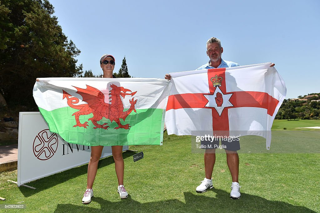 Darren Clarke and Amy Boulden pose with the flags of Northern Ireland and of Wales during The Costa Smeralda Invitational golf tournament at Pevero Golf Club - Costa Smeralda on June 25, 2016 in Olbia, Italy.