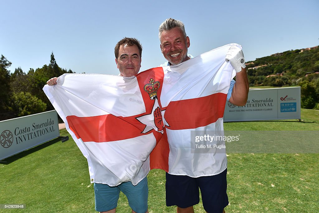 Darren Clarke (R) and Jimmy Nesbit pose with the flag of Northern Ireland during The Costa Smeralda Invitational golf tournament at Pevero Golf Club - Costa Smeralda on June 25, 2016 in Olbia, Italy.