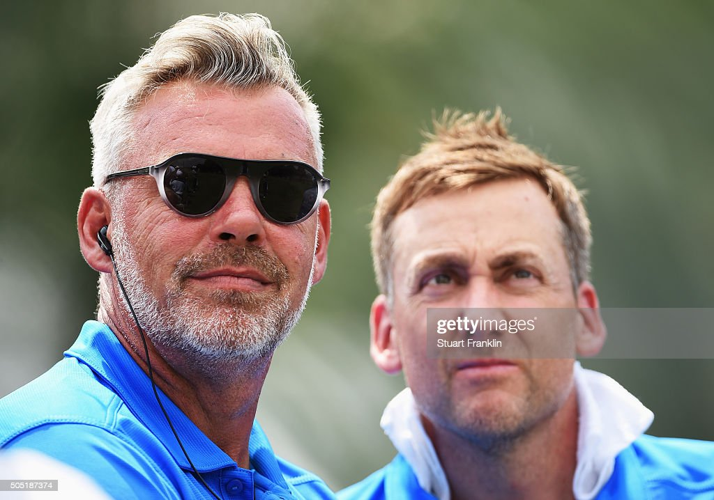 Darren Clarke Captain of team Europe and Ian Poulter look on during thee second day's foursome matches at the EurAsia Cup presented by DRBHICOM at...