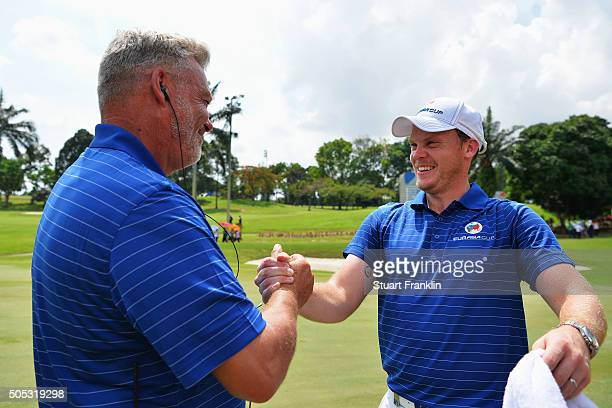 Darren Clarke Captain of team Europe congratulates Danny Willett of team Europe after his winning his singles match against Byeong Hun An of team...