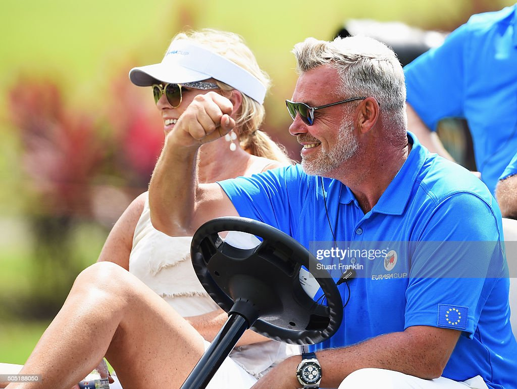 Darren Clarke Captain of team Europe pumps his fist as his wife Alison Campbell looks on during thee second day's foursome matches at the EurAsia Cup...
