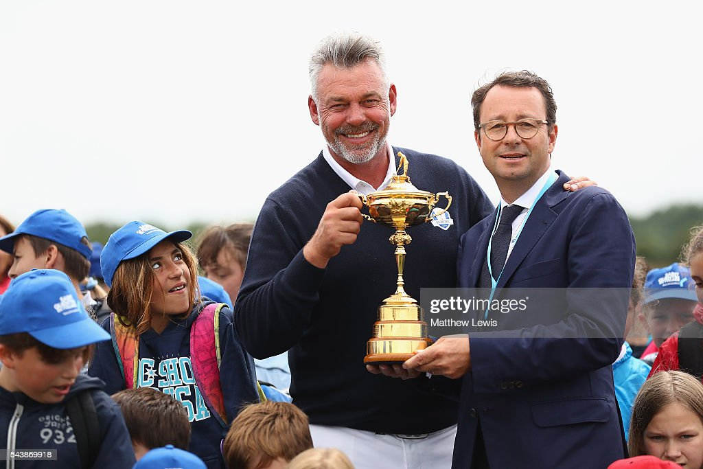 <a gi-track='captionPersonalityLinkClicked' href=/galleries/search?phrase=Darren+Clarke&family=editorial&specificpeople=171309 ng-click='$event.stopPropagation()'>Darren Clarke</a>, European Ryder Cup Team captain pictured with Pascal Grizot, president of Ryder Cup France and local school children, during a Mon Carnet de Golf Clinic during day one of the 100th Open de France at Le Golf National on June 30, 2016 in Paris, France.