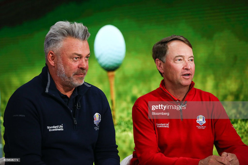 Darren Clarke, European team captain for the Ryder Cup 2016, left, listens as Davis Love III, the U.S. team captain, speaks during a Bloomberg Television interview in New York, U.S., on Thursday, April 28, 2016. They discussed this year's Ryder Cup and lessons learned from previous years' competitions. Photographer: Chris Goodney/Bloomberg via Getty Images