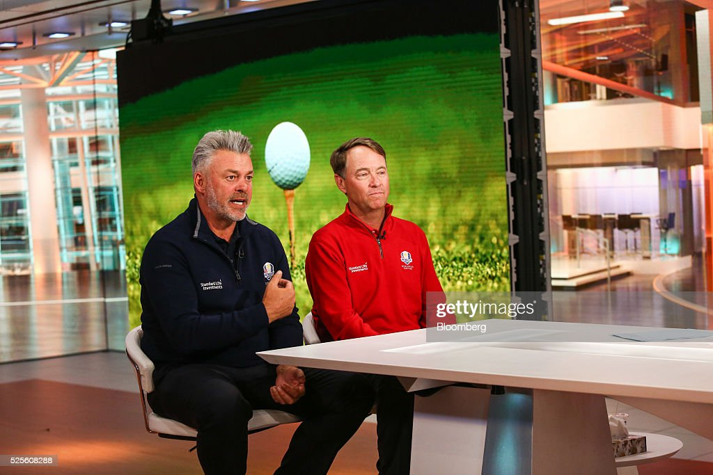 Darren Clarke, European team captain for the Ryder Cup 2016, left, speaks as Davis Love III, the U.S. team captain, listens during a Bloomberg Television interview in New York, U.S., on Thursday, April 28, 2016. They discussed this year's Ryder Cup and lessons learned from previous years' competitions. Photographer: Chris Goodney/Bloomberg via Getty Images