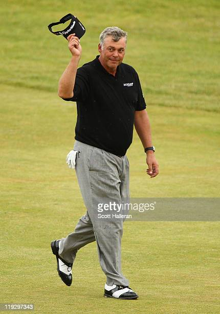 Darren Clarke of Northern Ireland acknowledges the crowd on the 18th green on his way to victory during the final round of The 140th Open...