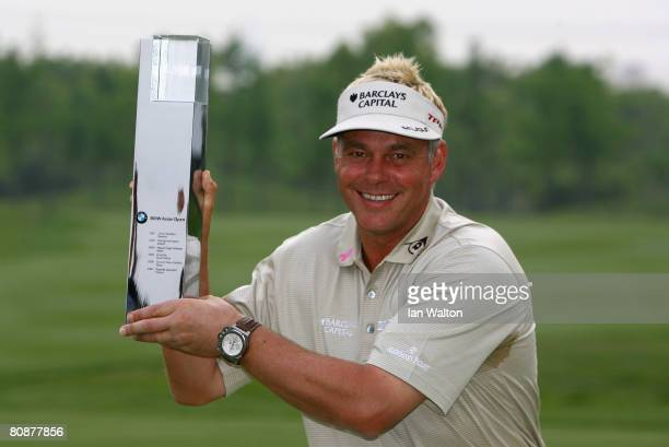 Darren Clarke of Northern Ireland celebrates with the trophy after winning the final round of the BMW Asian Open at the Tomson Shanghai Pudong Golf...