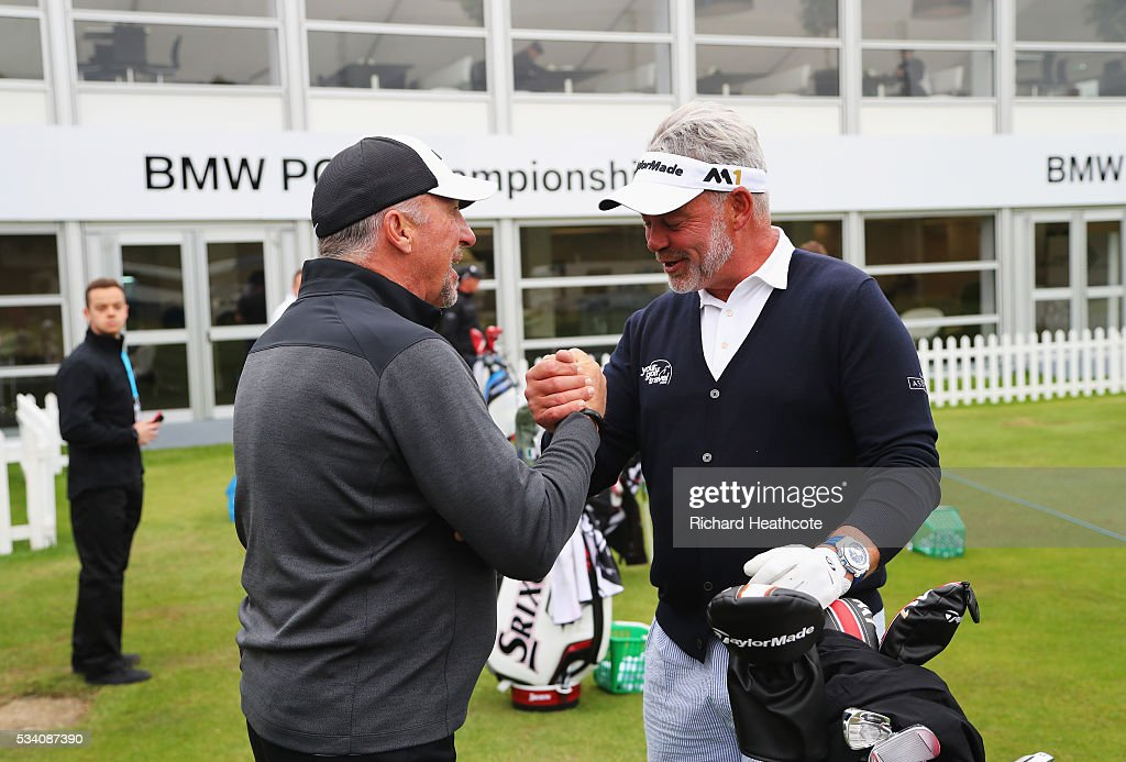 Darren Clarke of Northern Ireland greets former cricketer Sir Ian Botham during the Pro-Am prior to the BMW PGA Championship at Wentworth on May 25, 2016 in Virginia Water, England.
