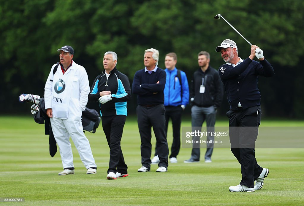 <a gi-track='captionPersonalityLinkClicked' href=/galleries/search?phrase=Darren+Clarke&family=editorial&specificpeople=171309 ng-click='$event.stopPropagation()'>Darren Clarke</a> of Northern Ireland hits an approach during the Pro-Am prior to the BMW PGA Championship at Wentworth on May 25, 2016 in Virginia Water, England.