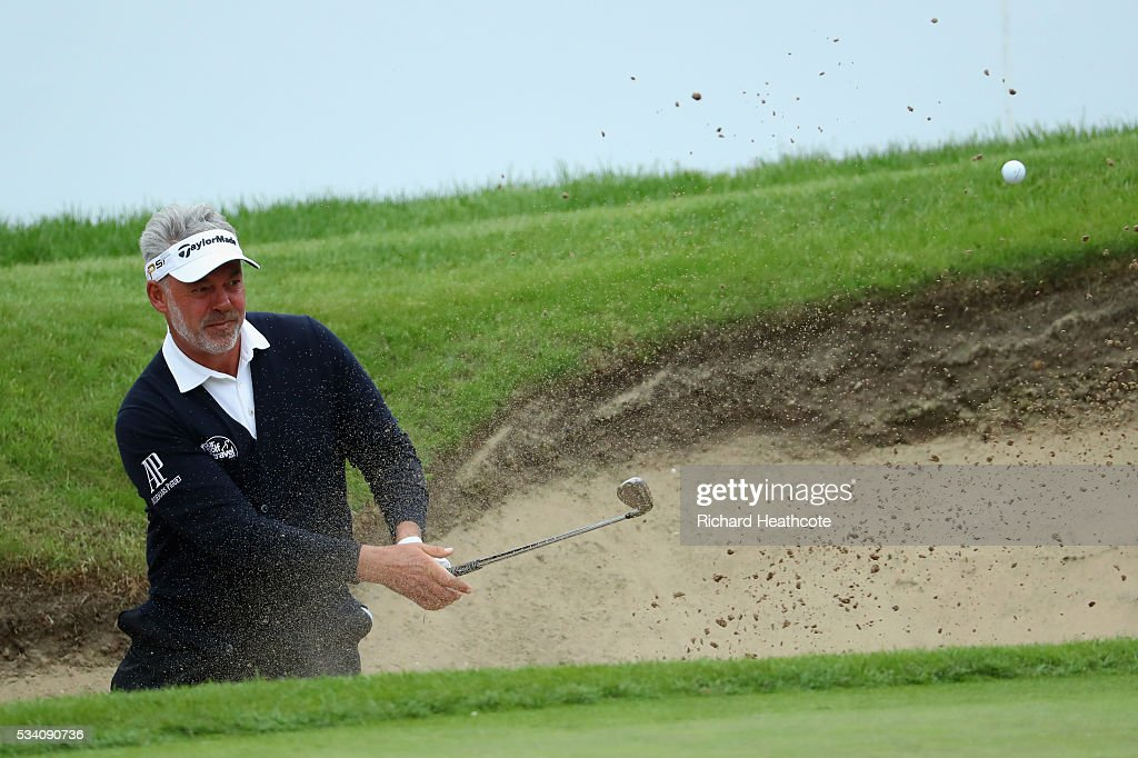 <a gi-track='captionPersonalityLinkClicked' href=/galleries/search?phrase=Darren+Clarke&family=editorial&specificpeople=171309 ng-click='$event.stopPropagation()'>Darren Clarke</a> of Northern Ireland hits from a bunker during the Pro-Am prior to the BMW PGA Championship at Wentworth on May 25, 2016 in Virginia Water, England.