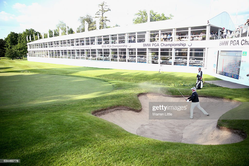 <a gi-track='captionPersonalityLinkClicked' href=/galleries/search?phrase=Darren+Clarke&family=editorial&specificpeople=171309 ng-click='$event.stopPropagation()'>Darren Clarke</a> of Northern Ireland hits from a bunker on the 18th hole during day one of the BMW PGA Championship at Wentworth on May 26, 2016 in Virginia Water, England.