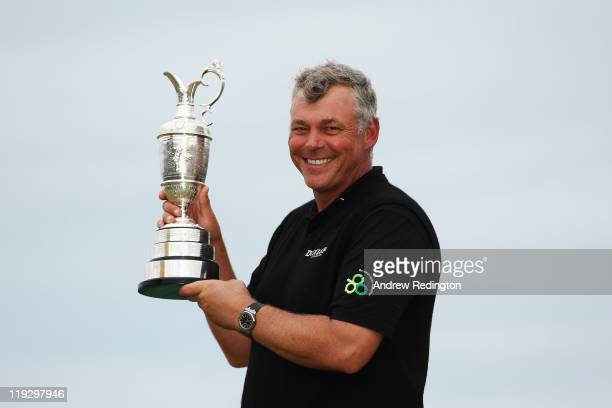 Darren Clarke of Northern Ireland holds the Claret Jug following his victory at the end of the final round of The 140th Open Championship at Royal St...