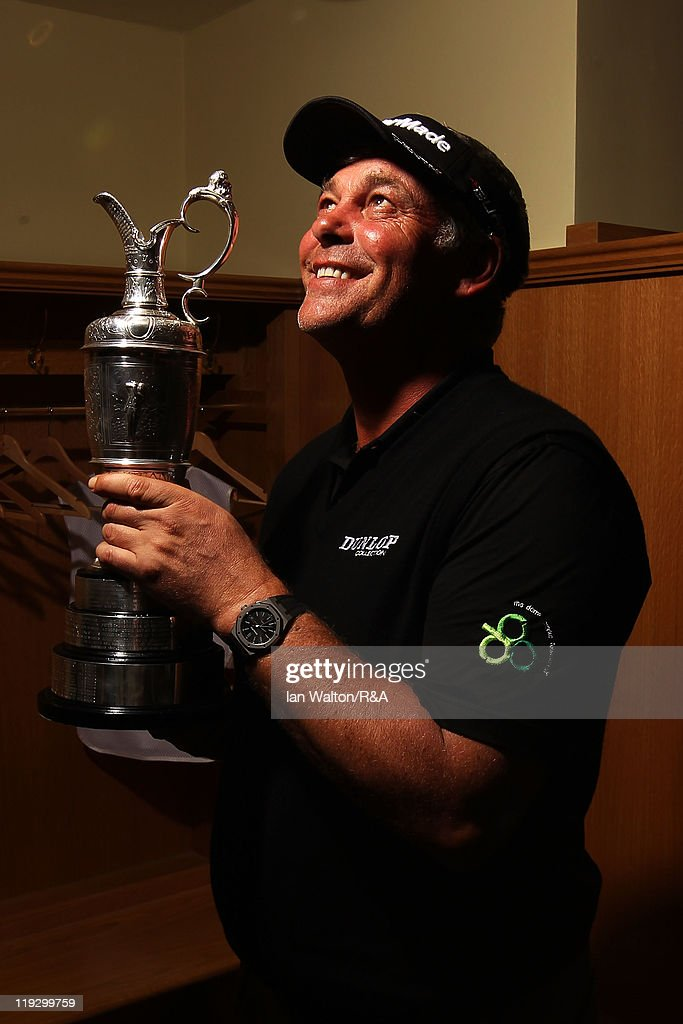 Darren Clarke of Northern Ireland holds the Claret Jug in the locker room following his victory at the end of the final round of The 140th Open Championship at Royal St George's on July 17, 2011 in Sandwich, England.