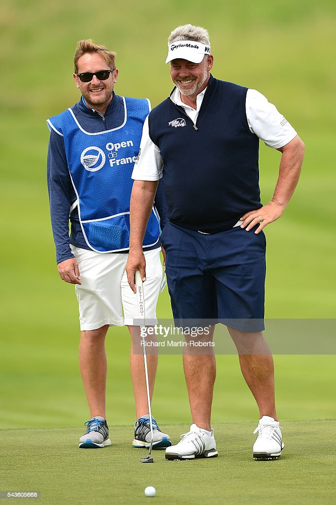 <a gi-track='captionPersonalityLinkClicked' href=/galleries/search?phrase=Darren+Clarke&family=editorial&specificpeople=171309 ng-click='$event.stopPropagation()'>Darren Clarke</a> of Northern Ireland looks on with caddie James Lane during a pro-am round ahead of the 100th Open de France at Le Golf National on June 29, 2016 in Paris, France.
