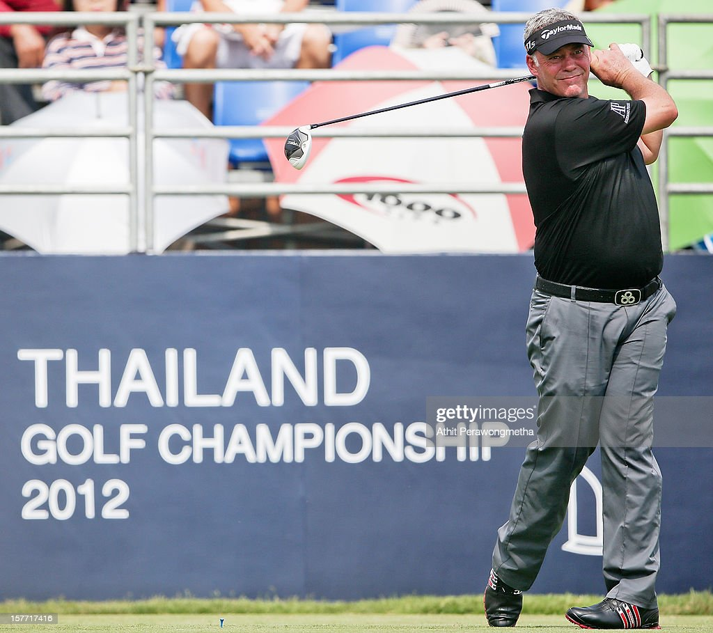 <a gi-track='captionPersonalityLinkClicked' href=/galleries/search?phrase=Darren+Clarke&family=editorial&specificpeople=171309 ng-click='$event.stopPropagation()'>Darren Clarke</a> of Northern Ireland plays a shot during round one of the Thailand Golf Championship at Amata Spring Country Club on December 6, 2012 in Bangkok, Thailand.