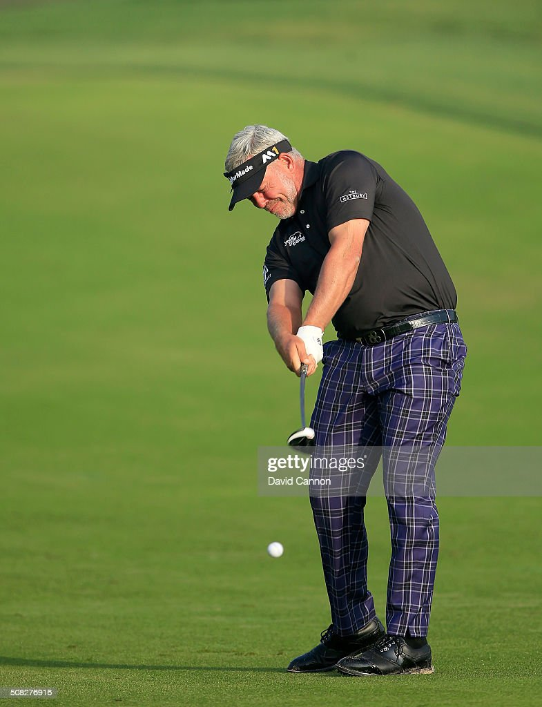 Darren Clarke of Northern Ireland plays his second shot on the par 5 10th hole during the first round of the 2016 Omega Dubai Desert Classic on the...
