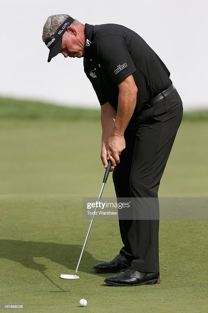 <a gi-track='captionPersonalityLinkClicked' href=/galleries/search?phrase=Darren+Clarke&family=editorial&specificpeople=171309 ng-click='$event.stopPropagation()'>Darren Clarke</a> of Northern Ireland putts on the 18th green during the first round of the Greenbrier Classic at the Old White TPC on July 3, 2014 in White Sulphur Springs, West Virginia.