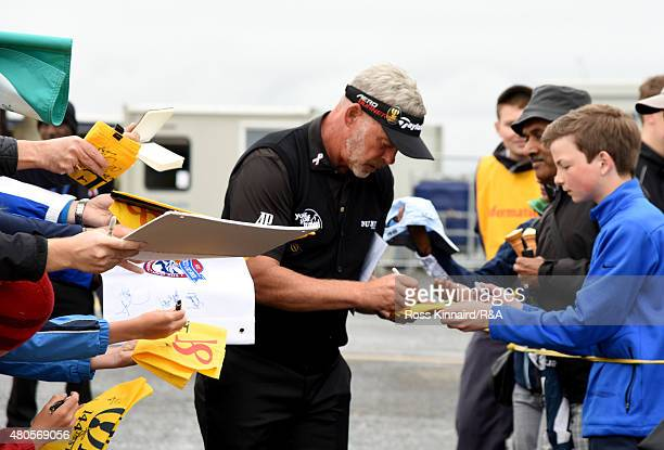 Darren Clarke of Northern Ireland signing autographs for spectators ahead of the 144th Open Championship at The Old Course on July 13 2015 in St...