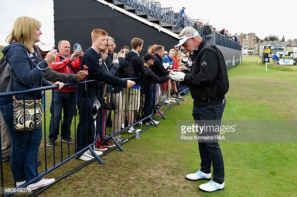 Darren Clarke of Northern Ireland signs his autograph for a fan ahead of the 144th Open Championship at The Old Course on July 14 2015 in St Andrews...