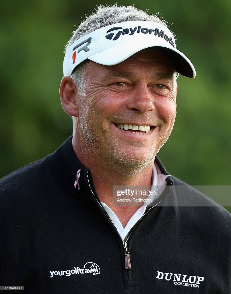 <a gi-track='captionPersonalityLinkClicked' href=/galleries/search?phrase=Darren+Clarke&family=editorial&specificpeople=171309 ng-click='$event.stopPropagation()'>Darren Clarke</a> of Northern Ireland smiles during the pro-am prior to the start of the Irish Open at Carton House Golf Club on June 26, 2013 in Maynooth, Ireland.