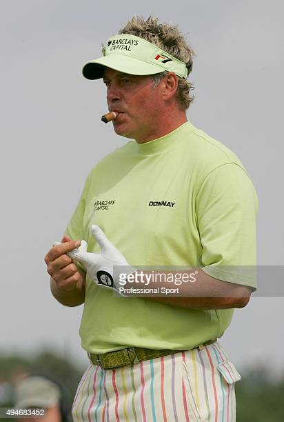 Darren Clarke of Northern Ireland smokes a cigar on the first hole during the first round of the 134th Open Championship at Old Course St Andrews...