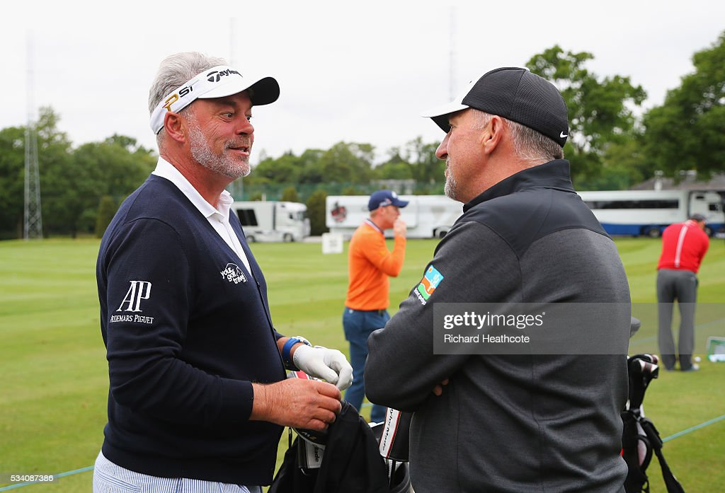 Darren Clarke of Northern Ireland talks with former cricketer Sir Ian Botham during the Pro-Am prior to the BMW PGA Championship at Wentworth on May 25, 2016 in Virginia Water, England.