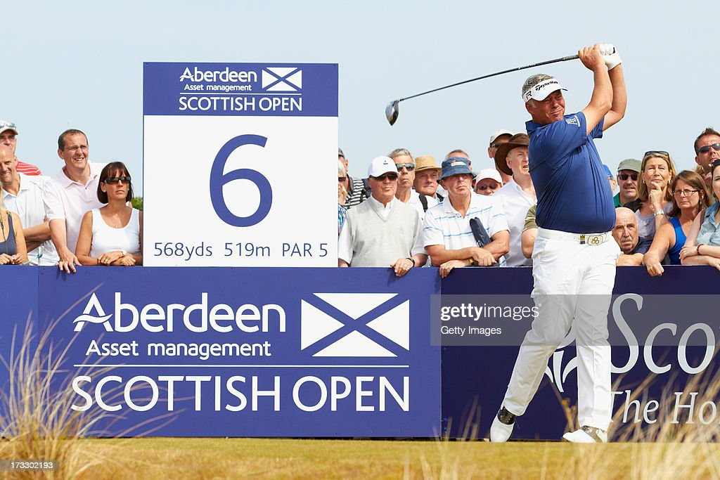 <a gi-track='captionPersonalityLinkClicked' href=/galleries/search?phrase=Darren+Clarke&family=editorial&specificpeople=171309 ng-click='$event.stopPropagation()'>Darren Clarke</a> of Northern Ireland tees off during the first round of the Aberdeen Asset Management Scottish Open at Castle Stuart Golf Links on July 11, 2013 in Inverness, Scotland.